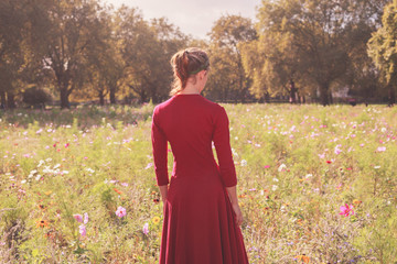 Young woman in meadow at sunset