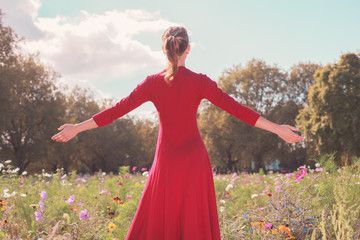 Young happy woman in a meadow