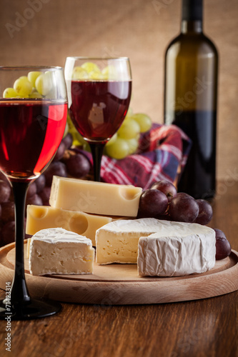 Cheese with a bottle and glasses of red wine - 71423314