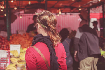 Young woman at fruit market
