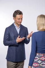 Young man coaching young women.