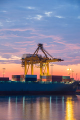 Industrial Container Cargo freight ship with working at twilight
