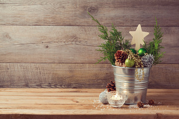Wooden table with Christmas decorations and copy space