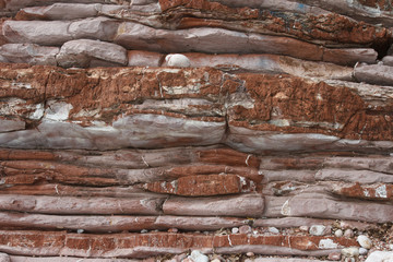 Texture of red rocks closeup