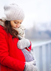 Pregnant woman in winter