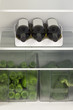 Refrigerator full of vegetables and wine