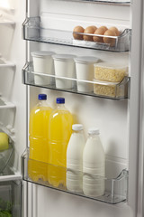 opened refrigerator full of foodstuff and drinks