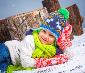Winter Fashion. Portrait of adorable happy boy.