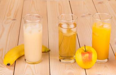Tasty various juices on wood table.