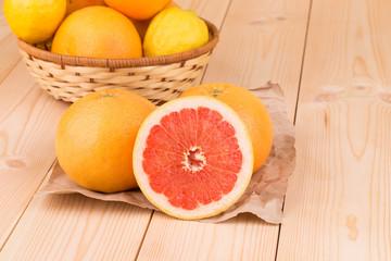 Fresh sliced grapefruits on wood table.