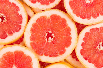 Close up of fresh sliced grapefruits.