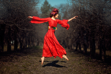 Girl in red dress soars.