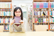 young asian student in the library
