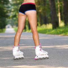 skinny blonde girl learn to roller skate