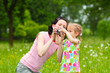little girl child to learn to photograph with his mother