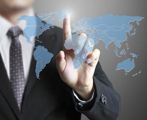 Business man touching world