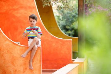 Cute little boy having fun outdoors