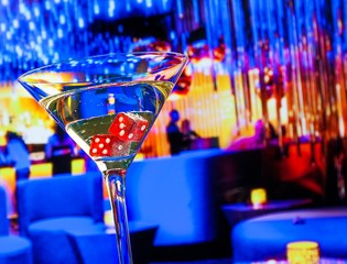 red dice in the cocktail glass in front of lounge bar casino