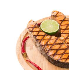 Salmon steak on wooden board