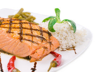 Salmon steak on white plate