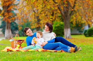 happy family enjoying autumn picnic