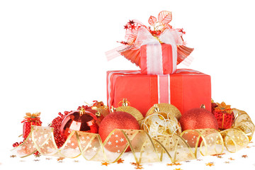 Christmas gifts and balls with gold ribbon isolated on a white b