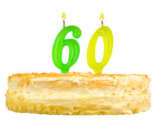 birthday cake with candles number sixty isolated on white