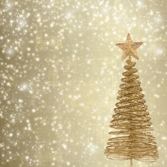 Christmas greeting card with gold metal firtree on the abstract