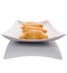 Popular traditional Malaysian snack curry puff on a white plate