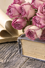 Dry roses and books