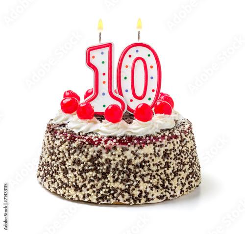Geburtstagstorte mit brennender Kerze Nummer 10 - 71433115