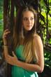 cute girl holding liana at jungle at sunset