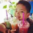 smile boy with colorful sweet drink