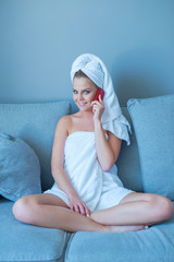 Woman on Couch Talking Through Phone After Bath