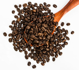 coffee beans on wood spoon, white background
