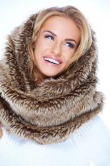 Smiling Blond Woman Wearing Fur Neck Warmer