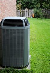 Modern air conditioner on backyard