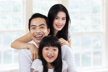 Cheerful family enjoy holiday at home
