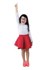 Cute girl raises hand in class