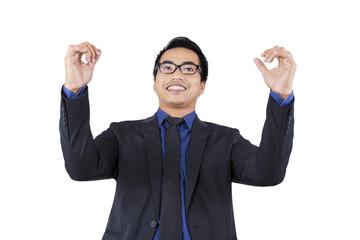 Excited businessman celebrate his achievement