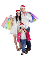 Family celebrate christmas with shopping