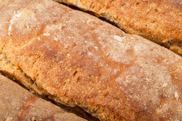 loaves of bread traditionally roasted.  Background. Close up.