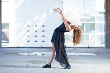 Contemporary ballet dancer performing in urban scene