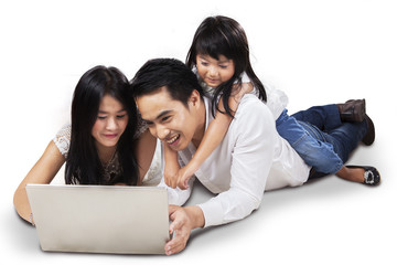 Family using laptop on the floor