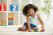 Kid girl playing toys at kindergarten room - 71435938