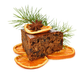 Slice of Christmas cake decorated with oranges