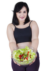 Happy pregnant mother with salad