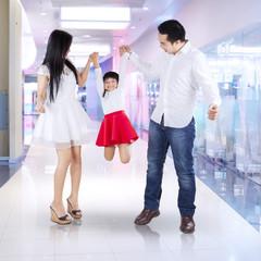 Joyful family playing at mall