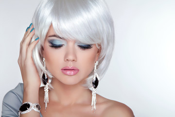 Beauty blond girl model with fashion earrings and White Short Ha