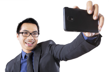 Joyful man taking self portrait